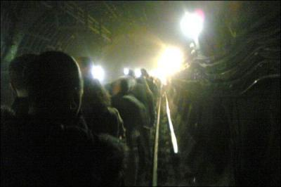 Mobile phone camera footage from inside one of the bombed tunnels, as scared passengers walk from their stalled train to the next station